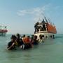 Somali refugees departing Shimbiro Beach to board smugglers' boats to Yemen